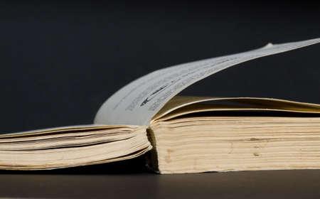 black backgound: Old battered book on a black backgound