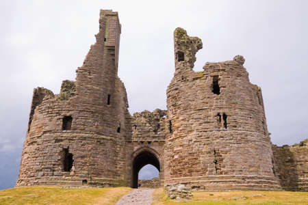gatehouse: Ruined Gatehouse of Dunstanburgh Castle on the Northumberland coast of England