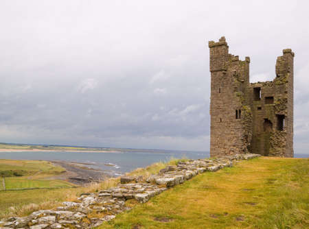 gatehouse: Ruined Tower of Dunstanburgh Castle on the Northumberland coast of England