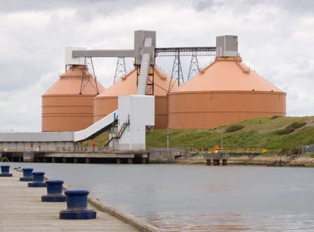 quayside: Three silos on a quayside Stock Photo
