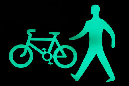 pelican: Walk and cycle sign showing safe to cross now Stock Photo