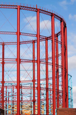 industrial heritage: Group of three English, restored gasholders in the sunlight