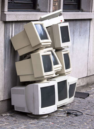 Pile of eight old crt monitors awaiting disposal