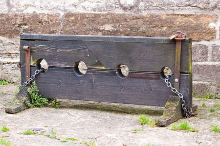 restraint device: Old English stocks for holding and humiliating wrong doers