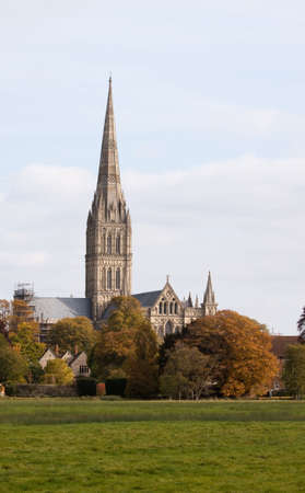Salisbury Cathedral in autumn viewed across the water meadows. Built 750 years ago Salisbury Cathedral has the tallest spire in the UK