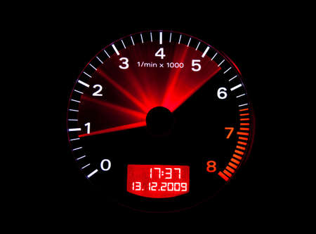 Close up of a tachometer or rev counter with needle motion blur