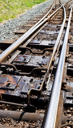 narrow gauge: Narrow guage railway points showing greased up switching mechanism Stock Photo