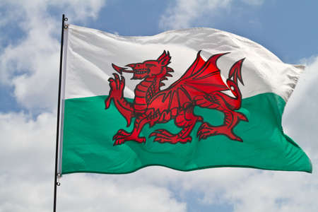 welsh flag: The flag of Wales flying in sunshine Stock Photo