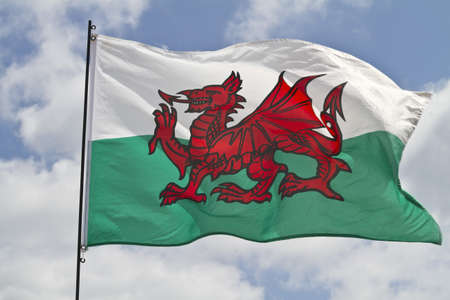 The flag of Wales flying in sunshine Stok Fotoğraf