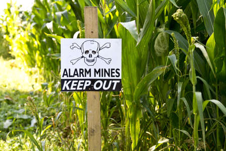 explosive sign: Land mine keep out warning sign Editorial