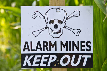 landmine: Land mine keep out warning sign Editorial