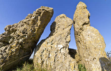 sigmoid: The Whispering Knights neolithic dolman or burial site, Cotswolds, UK, part of the Rollright group