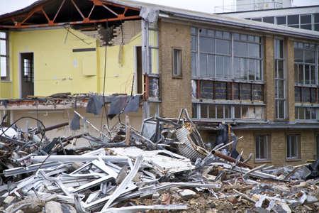 Demolition site with focus on freground debris