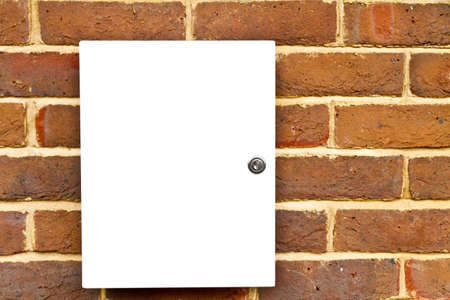Closed locked white cupboard on a brick wall Stock Photo - 13817413