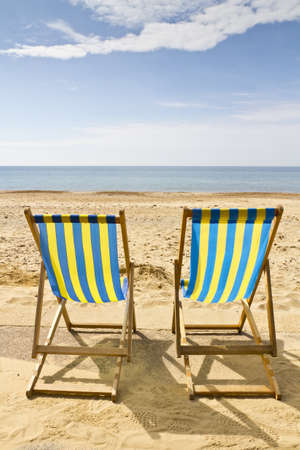 Two deck chairs on the beach at Bournemouth, Dorset,UK on a bright sunny summer day