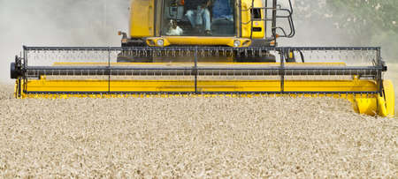 Close up of a combine harvester at work from the front photo