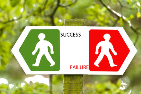 Sign pointing to left and right, success and failure