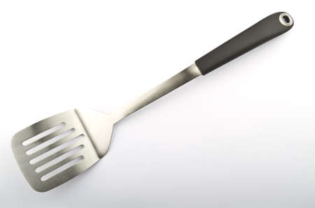 Stainless steel spatula on a plain background Stock Photo