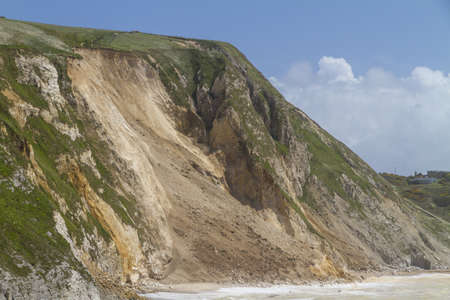 mud slide: Major cliff collapse landslide on the Jurassic coast, Dorset, UK destroying the coastal path and discolouring the sea Stock Photo