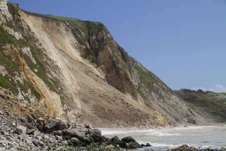 coastal erosion: Major cliff collapse landslide with forground rock fall on the Jurassic coast, Dorset, UK destroying the coastal path and discolouring the sea