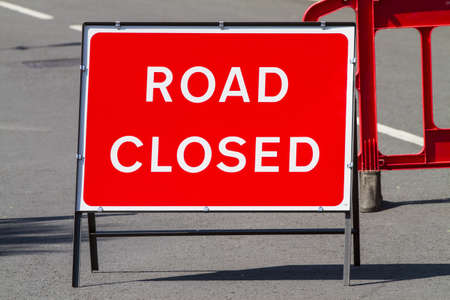 Temporary red road closed sign photo