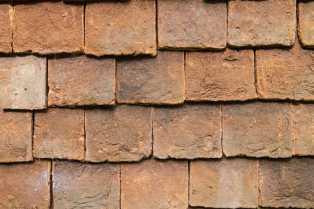 weald: Close up of clay external wall tiles used to partially clad the outside of buildings . Weald,England