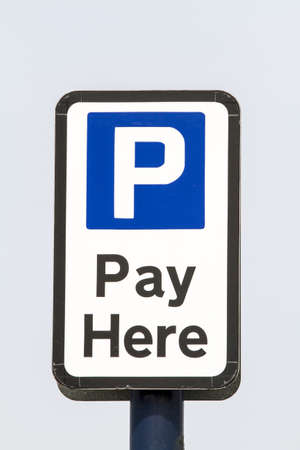 Car park pay sign against a blue sky Stok Fotoğraf
