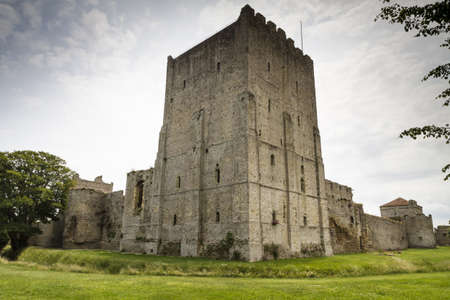 moat wall: The medieval castle of Portchester is set within the walls of a 3rd-century Roman fort  The great Tower was built in the twelth century and a royal residence was added in the 1390s Editorial