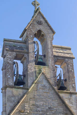 church bells: Cotswold village Church bell tower with three bells. St Marys, Lower Swell, Gloucestershire,England,UK