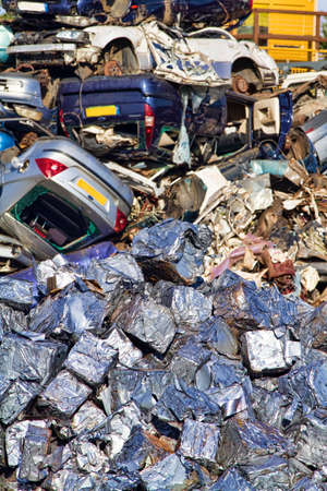 compaction: Cars crushed into cubes in foreground with those awaiting compaction in the background Stock Photo