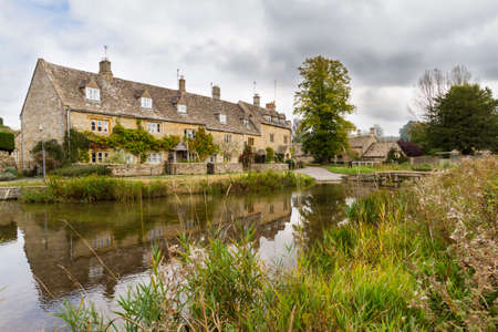 cotswold: Stream running through the picturesque Cotswold village of Lower Slaughter, Gloucestershire, England
