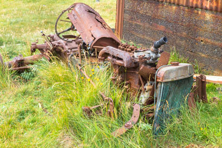 scrap iron: Abandoned derelict tractor in advanced stage of rusting to pieces