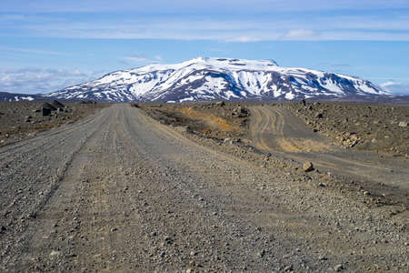 southwest: Icelandic dirt track (550) in south west highlands with snow covered Ok shield volcano in the backgroud