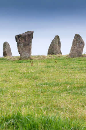 derbyshire: Four remaining Neolithic Standing Stones at Nine Stones Close, Harthill Moor Derbyshire, England. The stones are around 2m tall