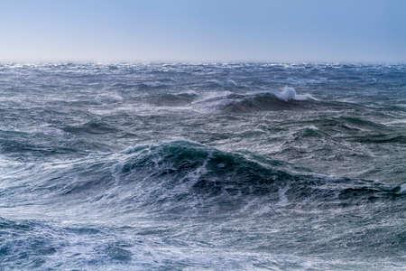 Rough sea on a sunny day at Portland Bill, England