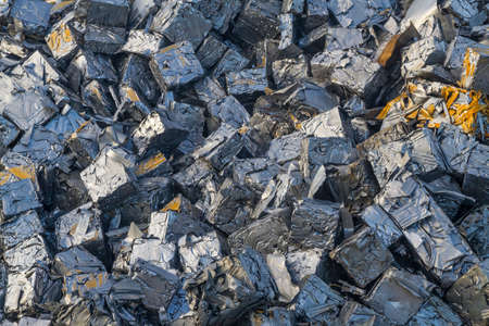 recycle: Close up of a pile of crushed cars all reduced to cubes of metal Stock Photo