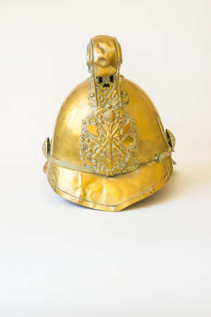 British Other Ranks Merryweather Brass Fire Helmet, used during the blitz, Second World War, with consequent damage Stock Photo