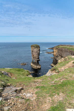 Yesnaby Sea Stack,west Orkney mainland, UK. An imposing sea stack perched on a precarious looking arch Stock Photo