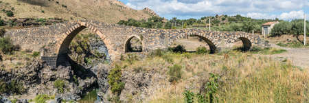 Panorama of Ponte di Saraceni, near Adrano, Sicily, Italy, probably dates to Roman times and has been rebuilt repeatedly. It crosses the river Simeto and joins the areas of Adrano and Centuripe