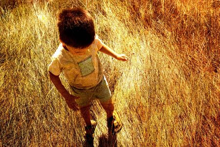 Child in savanna Stock Photo
