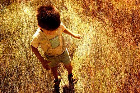Child in savanna Stock Photo