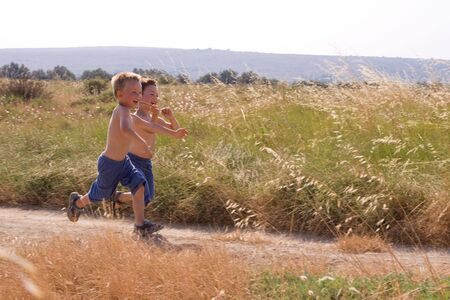 Young children running in the nature