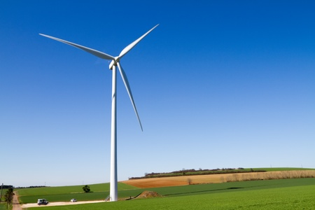 Wind turbine under clear blue sky photo