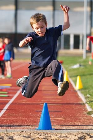 atleta corriendo: Salto de longitud Foto de archivo