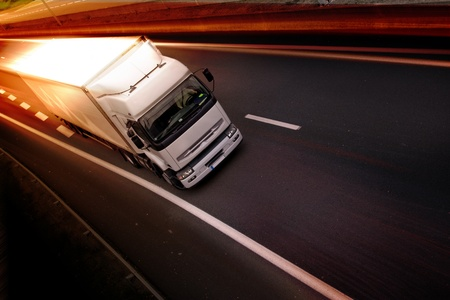 moving truck: A white truck on highway - delivery concept Stock Photo
