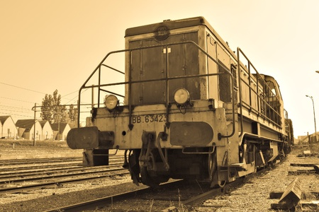 An old locomotive in a railway station photo