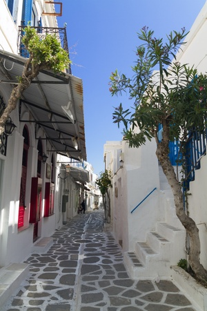 Classical Greek narrow street with a painted sidewalk in parikia