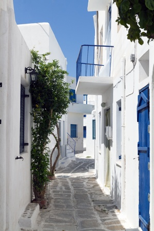 Classical narrow street with a painted sidewalk in Parikia photo
