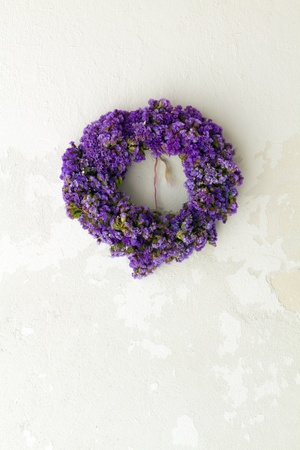 flower wreath on white wall - greece photo