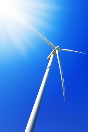 A wind turbine under clear blue sky photo